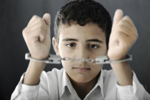 Child with handcuffs on